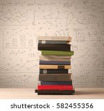 a pile of books with math... | Shutterstock . vector #582455356