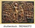 Small photo of KOLKATA,INDIA - FEBRUARY 09: Plucking off the hair with his own hands and accepting the vow of renunciation, Street bass relief on the wall of Jain Temple (also called Parshwanath Temple) in Kolkata.