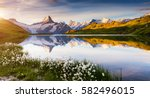 Great view of Bernese range above Bachalpsee lake. Dramatic and picturesque scene. Popular tourist attraction. Location place Swiss alps, Grindelwald valley, Europe. Artistic picture. Beauty world. - stock photo