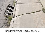Cracked Urban Sidewalk - stock photo