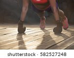 strong young woman doing push... | Shutterstock . vector #582527248