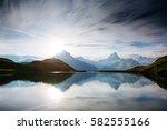 high mountain peaks glowing in... | Shutterstock . vector #582555166