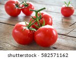 sweet tomatoes isolated on... | Shutterstock . vector #582571162