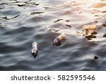 plastic garbage in the river on ... | Shutterstock . vector #582595546
