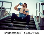 portrait of young man drinking... | Shutterstock . vector #582604438