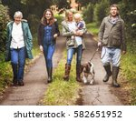 Stock photo family walking dog togetherness nature concept 582651952