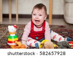 little baby girl crying on the... | Shutterstock . vector #582657928