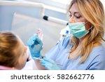 female dentist with dental... | Shutterstock . vector #582662776