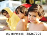 Happy group of children on shore - stock photo