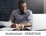 happy confident young african... | Shutterstock . vector #582687646