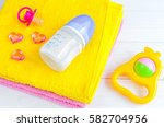 baby bottle with milk and towel ... | Shutterstock . vector #582704956