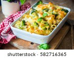 pasta bake with broccoli and... | Shutterstock . vector #582716365