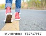 happy asian girl backpack  in... | Shutterstock . vector #582717952