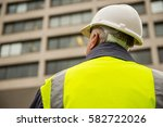 rear view of building inspector ... | Shutterstock . vector #582722026