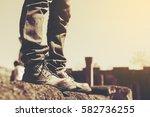 the feet of a man standing on a ... | Shutterstock . vector #582736255