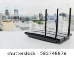 black three poles wifi router... | Shutterstock . vector #582748876