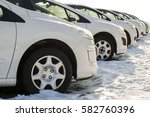 parked cars on a lot. row of... | Shutterstock . vector #582760396
