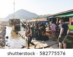 Small photo of LUANG PRABANG, LAOS - February 16, 2017: Tourists while leaving the ship after a cruise slow boat from the Mekong River to Luang prabang, Laos.