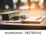 book  note  pens  glasses on... | Shutterstock . vector #582783142