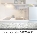 table top and blur kitchen room ...   Shutterstock . vector #582796456