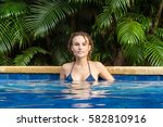 in the pool on a hot day  she... | Shutterstock . vector #582810916