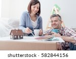 happy couple designing their...   Shutterstock . vector #582844156