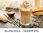 iced caramel latte coffee in a... | Shutterstock . vector #582849292