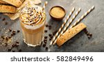 iced caramel latte coffee in a... | Shutterstock . vector #582849496