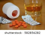 pills and alcohol on the table  ...   Shutterstock . vector #582856282