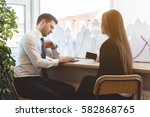 man looking to watches on the... | Shutterstock . vector #582868765