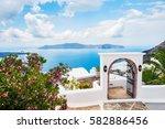 white architecture on santorini ... | Shutterstock . vector #582886456