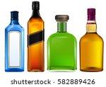 colorful alcohol bottles set | Shutterstock .eps vector #582889426