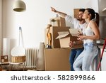 young couple moving in new... | Shutterstock . vector #582899866