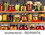 jars with variety of pickled...   Shutterstock . vector #582906076