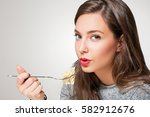gorgeous young brunette woman... | Shutterstock . vector #582912676
