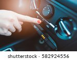 woman turns on air conditioning ... | Shutterstock . vector #582924556
