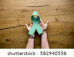 hands hold show green ribbon... | Shutterstock . vector #582940558