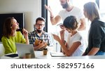 group of young freelancers is... | Shutterstock . vector #582957166