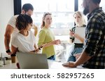 marketing specialists are... | Shutterstock . vector #582957265