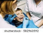 dentists with a patient during... | Shutterstock . vector #582963592