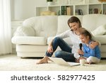 mother and daughter singing... | Shutterstock . vector #582977425