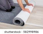 close up of worker's hands... | Shutterstock . vector #582998986