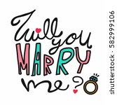 will you marry me word and ring ... | Shutterstock .eps vector #582999106