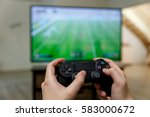 man playing video game. hands... | Shutterstock . vector #583000672