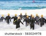 triathlon competitors in swim... | Shutterstock . vector #583024978