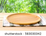 empty wooden tray on table over ... | Shutterstock . vector #583030342