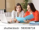 two businesswomen consulting a... | Shutterstock . vector #583038718