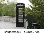 Phone Booth In The Garden