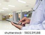 doctor using digital tablet...   Shutterstock . vector #583139188