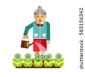 grandmother watering flowers in ...
